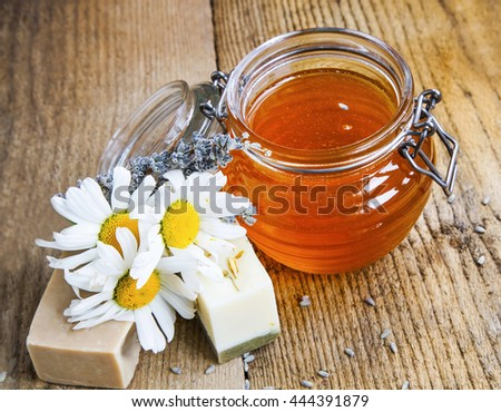 Natural handmade soaps with honey, lavender and chamomile.Natural beauty treatment - stock photo