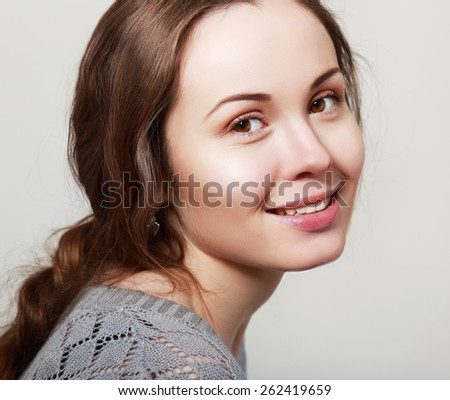 Natural health beauty of a woman face candid smiling - stock photo