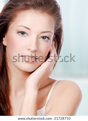 Natural health beauty  of a woman face - colored background - stock photo