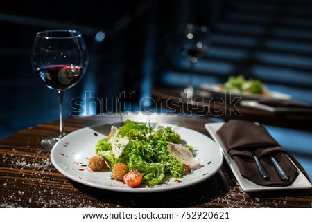 natural healthy food with french or italian alcohol; chicken salad with red wine;