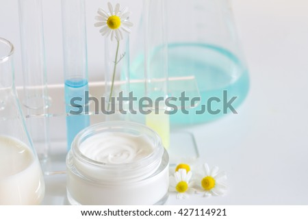 Natural herbal healthy cosmetics in the lab abstract with chamomile - stock photo