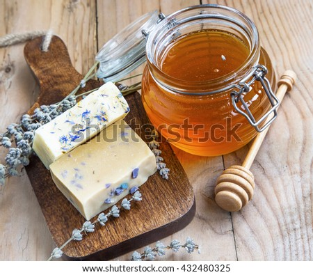 Natural homemade honey and lavender soaps, homemade spa setting - stock photo