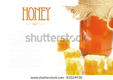 Natural honey in honeycombs. Honey in bank. A place for your text. - stock photo
