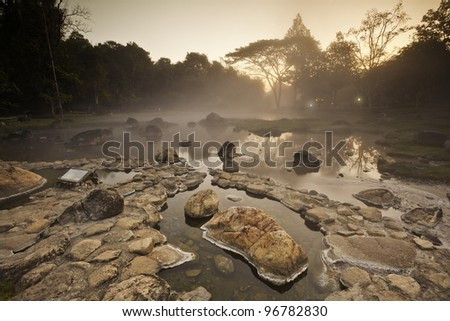 Natural hot spring in the morning - stock photo