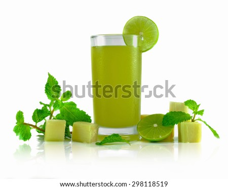 natural juice making from the sugarcane decoration with lime,mint on white background