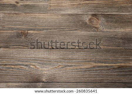 Natural knotted brown weathered wood plank texture background. - stock photo