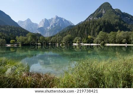 Natural lake in Alps - stock photo