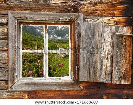 Natural landscape in Wood window - stock photo
