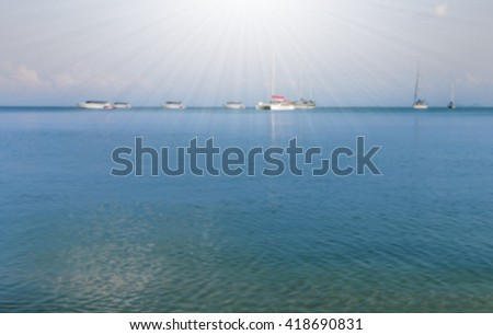 Natural landscape. Island,  blue sky and ocean with sailboat on sunshine day - stock photo