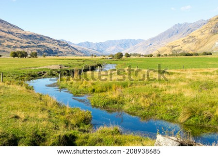 Natural landscape of New Zealand alps and stream - stock photo