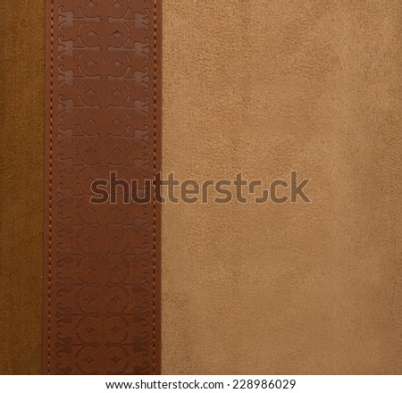Natural leather chamois border with stamping ornament brown and beige color sewed with stitches  - stock photo