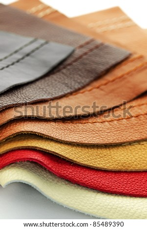 Natural leather upholstery samples with stitching in various colors - stock photo