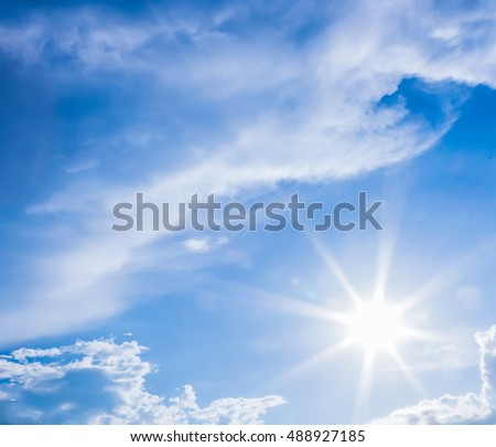 natural lens flare and radiating rays in a blue sky with clouds. That suitable for background, backdrop, wallpaper, display and artwork design.