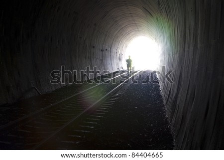 Natural light and shadow. In the tunnel. - stock photo