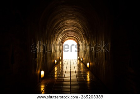 Natural light at the end of the tunnel. - stock photo