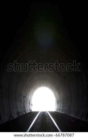 Natural light at the end of tunnel. - stock photo