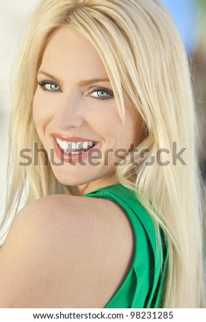 Natural light portrait of a happy smiling beautiful blond woman with blue eyes - stock photo