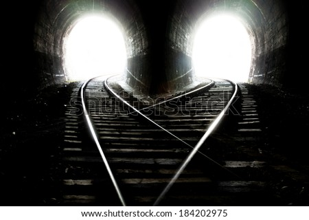Natural lights at the end of the tunnel. Selective focus over line - stock photo
