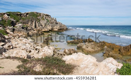 Natural limestone cliffs along the beach with the Indian Ocean waters at Penguin Island in Rockingham, Western Australia/Limestone Cliffs/Penguin Island, Rockingham, Western Australia - stock photo
