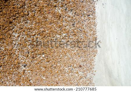 Natural line of contrasting white soil & orange stones - stock photo