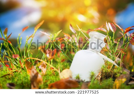 Natural medicine or cosmetics. Bottle on the moss. - stock photo