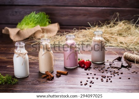 Natural milkshakes on the background of hay and sackcloth. Beautiful interer. - stock photo