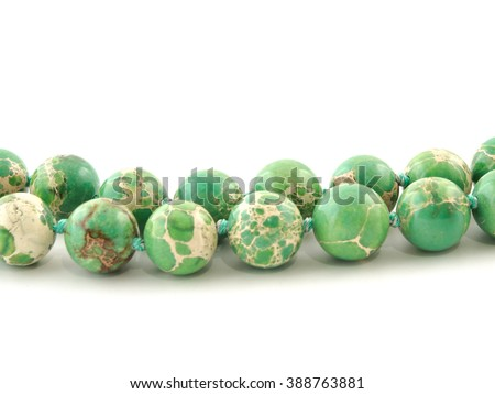 Natural mineral rock green Variscite gem stone isolated on white background.