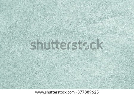 Natural mint color suede texture as background. - stock photo