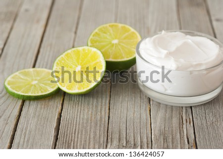 natural moisturizer cream with fresh lime on wooden