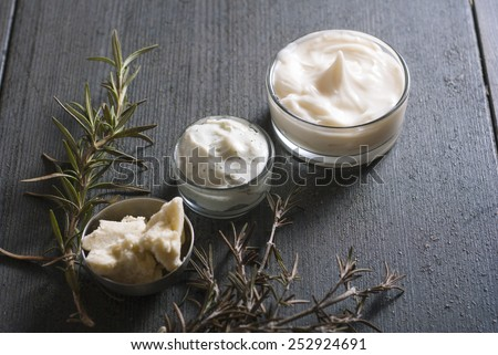 natural moisturizers on dark wooden table - stock photo