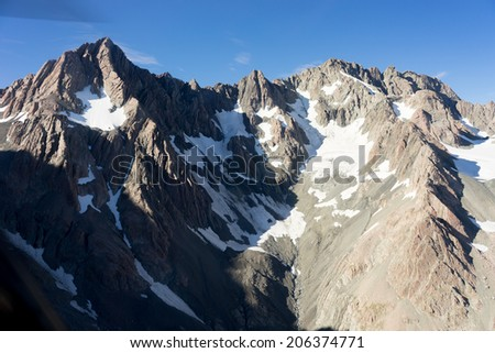 Natural mountain landscape with snow and clear blue sky
