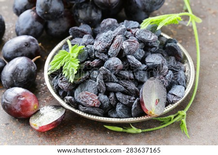 Natural organic dried grapes raisins, rustic still life - stock photo