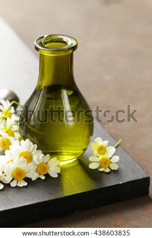 Natural organic herbal essence in a glass bottle - stock photo
