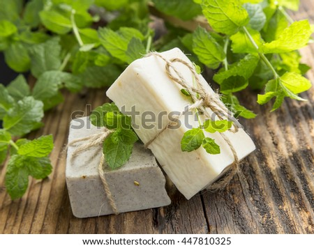 Natural organic mint soaps with mint leaves on wooden background