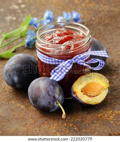 natural organic plum jam with fresh berries - stock photo