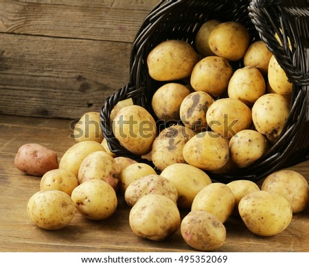 natural organic raw potatoes on a wooden table