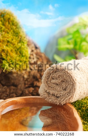 Natural outdoor spa setting with tree and mountains. - stock photo