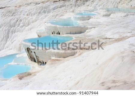 Natural Pamukkale basins full of water - stock photo