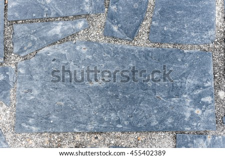 Natural paving stone slabs flor, walkway or sidewalk texture. Traditional fence, court, backyard or road paving. - stock photo