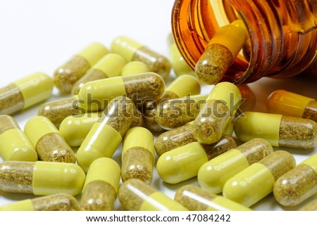 natural pills isolated on white background