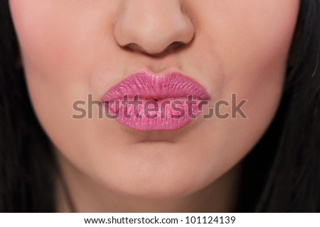 Natural pink lips with kissing gesture, close-up - stock photo
