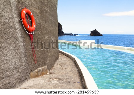 Natural pools Madeira island in Portugal - stock photo