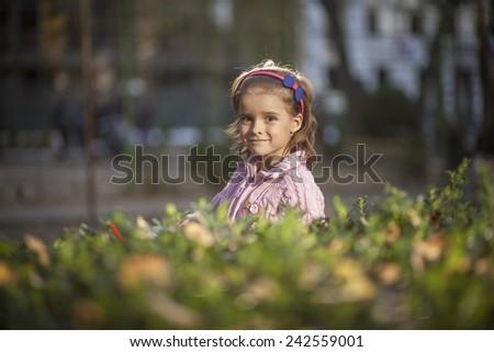 Natural portrait of a happy pretty little girl - stock photo