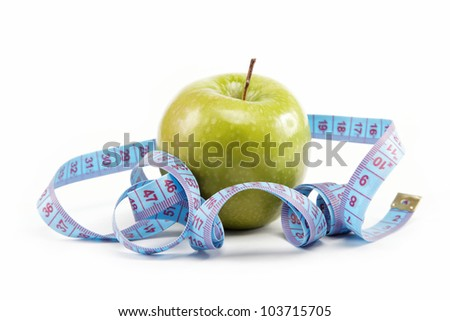Natural products. Diet. Fresh apple with a measuring tape on a white background.