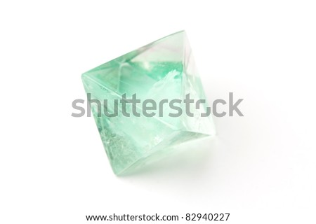 Natural raw fluorite crystal isolated on white. - stock photo