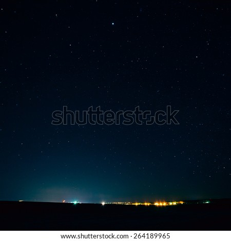 Natural Real Night Sky Stars Background Texture Over City - stock photo