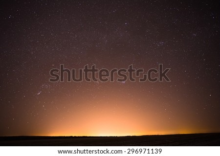 Natural Real Night Sky Stars Background Texture. Sunset, Sunrise Over Field - stock photo