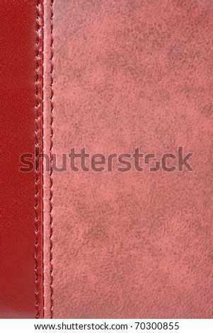 Natural red leather background closeup - stock photo