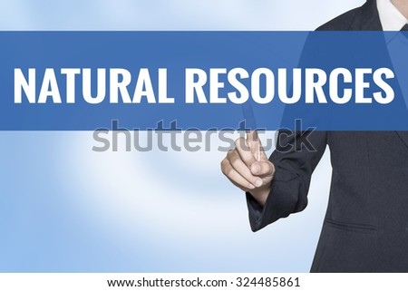 Natural Resources word on virtual screen touch by business woman blue background - stock photo