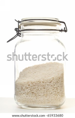 natural rice in jar on white background